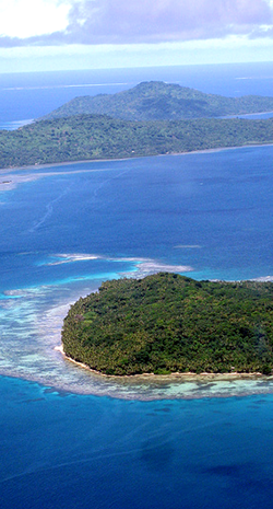 Aerial view of islands with horizon in background.